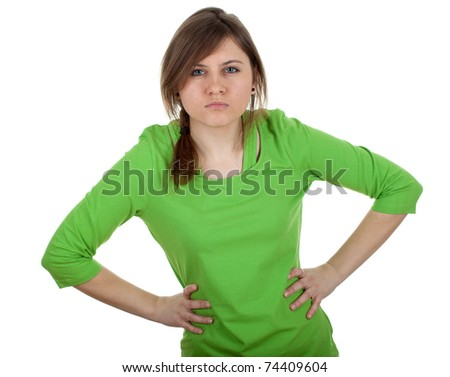 angry, irritated young woman in green blouse - stock photo
