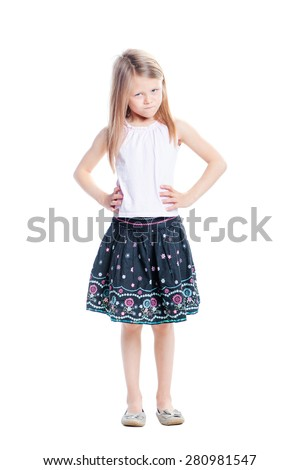 Angry kid. Full length portrait of annoyed little girl. Isolated on white. - stock photo