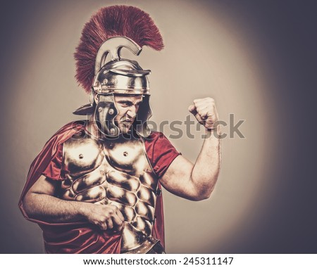 Angry legionary soldier in armour  - stock photo