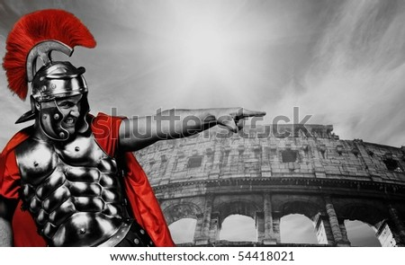 Angry legionary soldier in front of coliseum - stock photo