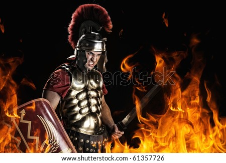 Angry legionary soldier in the fire - stock photo