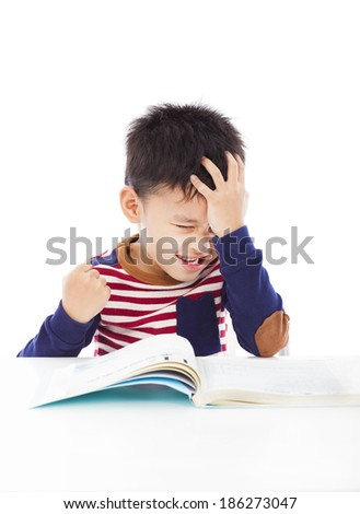 angry little boy hold head and make a fist - stock photo