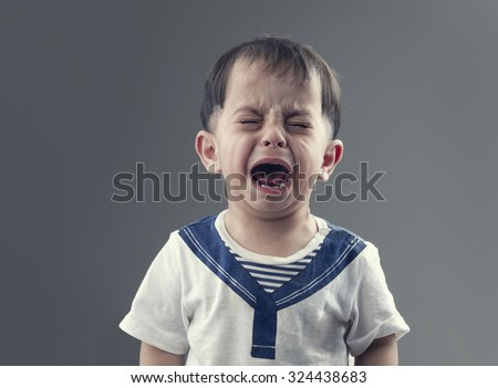 Angry little boys with sad expressions, screaming and crying - stock photo
