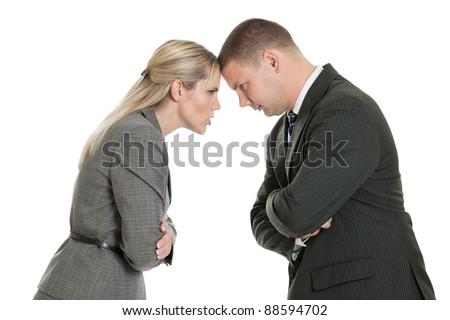 Angry male and female business people butting heads isolated on a white background - stock photo