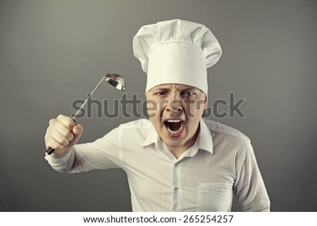 angry male chef - stock photo