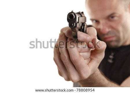 Angry man aims with handgun - stock photo