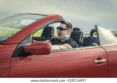 Angry man driving a cabriolet car. Toned image. - stock photo