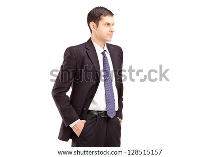 Angry man in suit with hands in pockets shot during an argue isolated on white background - stock photo