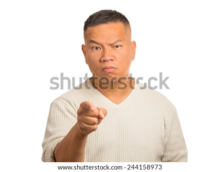 Angry man pointing his finger at somebody isolated on white background - stock photo