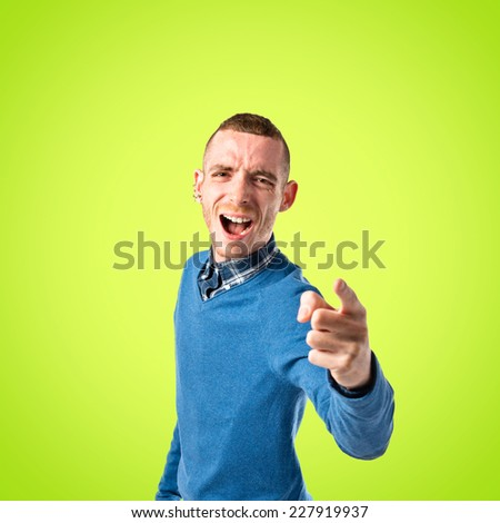 angry man shouting over green background  - stock photo
