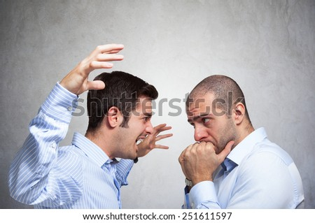 Angry man shouting to another man - stock photo