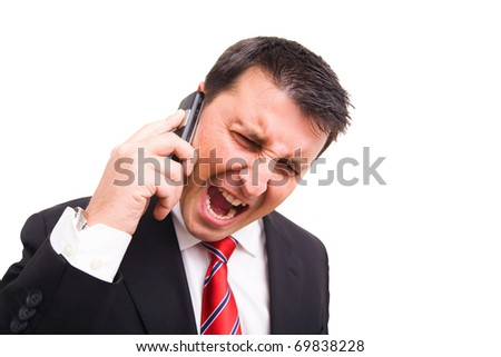 Angry man yelling on phone, frustrated - stock photo