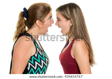 Angry mother and her teenage daughter yelling at each other  - Isolated on a white background - stock photo