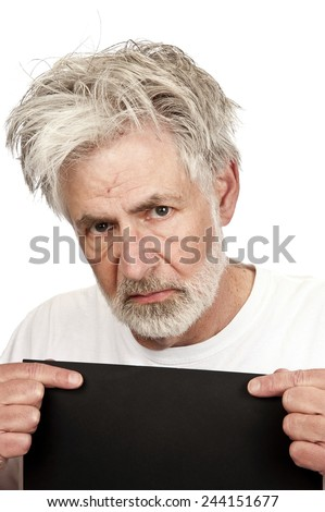 Angry Older Man Being Booked Into Jail With Copy Space/ Mug Shot - stock photo