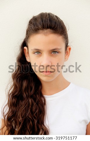 Angry preteen girl with blue eyes outdoor - stock photo