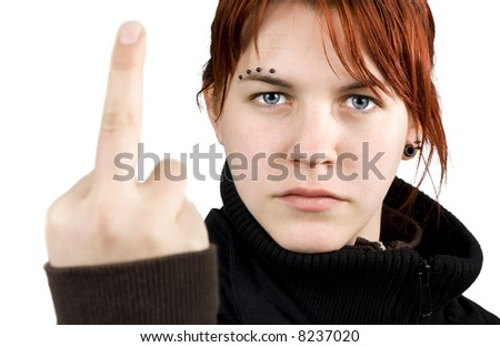 Angry redhead girl showing middle finger. - stock photo