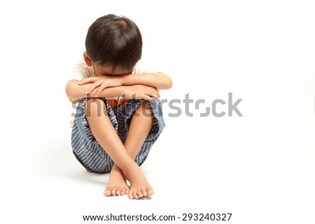 Angry sad child boy punishment ,isolated on white background - stock photo