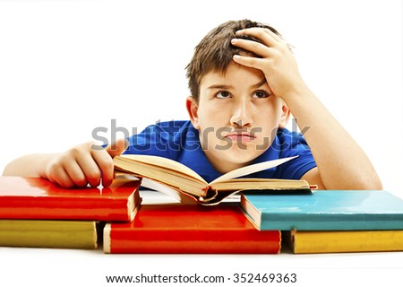 Angry schoolboy with learning difficulties, looking up.  Isolated on a white background - stock photo