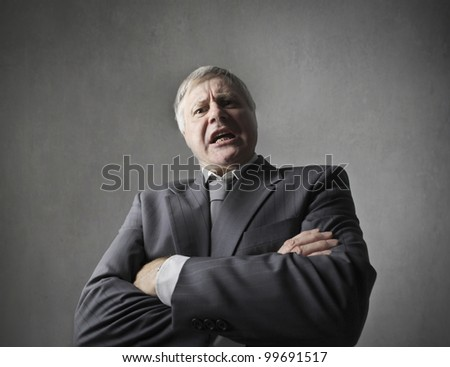 Angry senior businessman quarreling - stock photo