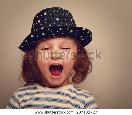 Angry shouting kid girl with open mouth. Closeup vintage portrait - stock photo