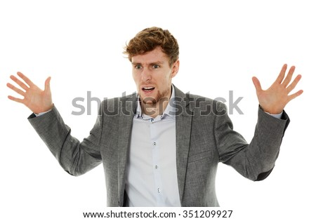 Angry stressed young businesswoman over white background - stock photo