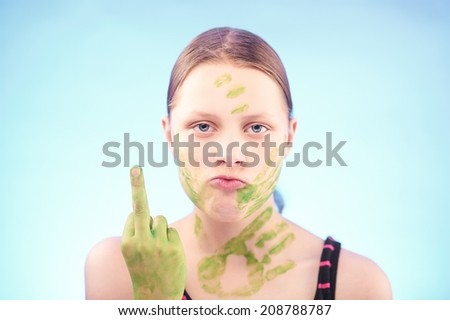 Angry teen girl badly gesturing and grimacing - stock photo
