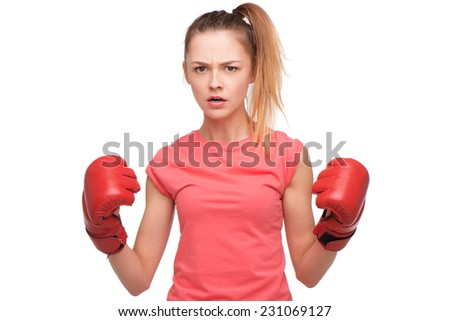 Angry teen girl with boxing gloves - stock photo
