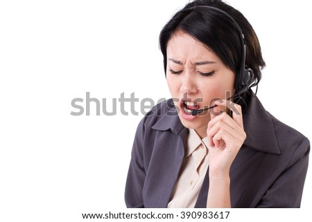 angry, upset business woman with headset - stock photo