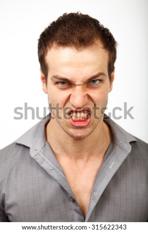 Angry upset man with scary evil face - stock photo