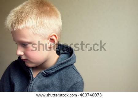 Angry upset sad child (boy, kid) portrait  - stock photo