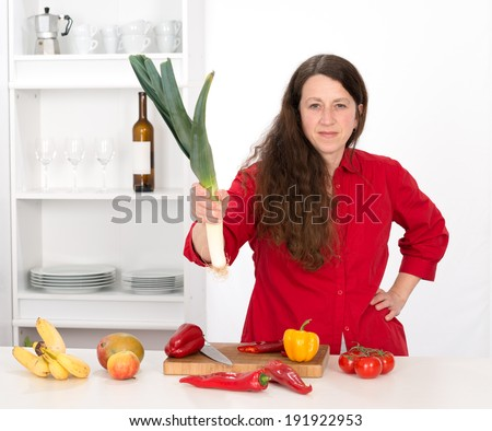 angry woman in the kitchen - stock photo