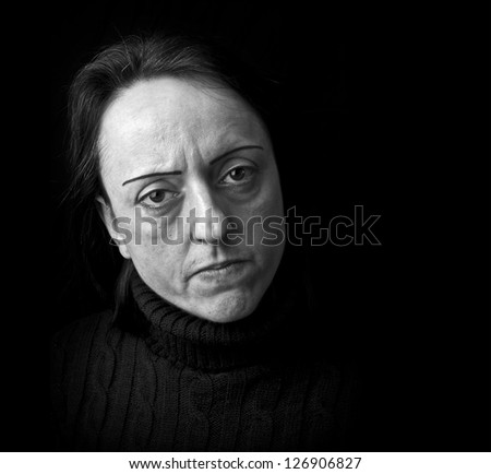 angry woman on black background with copy space - stock photo