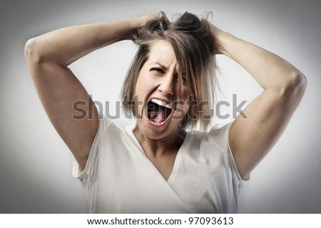 Angry woman screaming - stock photo