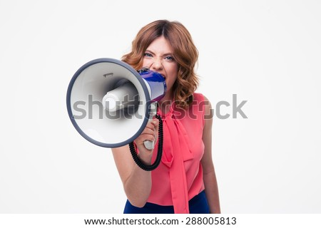 Angry woman shouting in megaphone isolated on a white background - stock photo