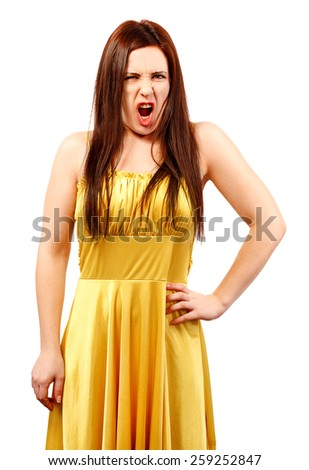 Angry woman woman in a yellow dress screaming isolated on white background - stock photo