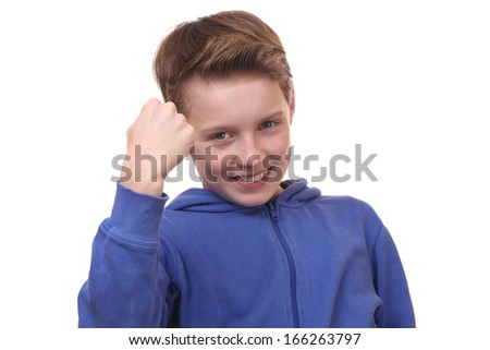 Angry young boy is ready to fight - stock photo