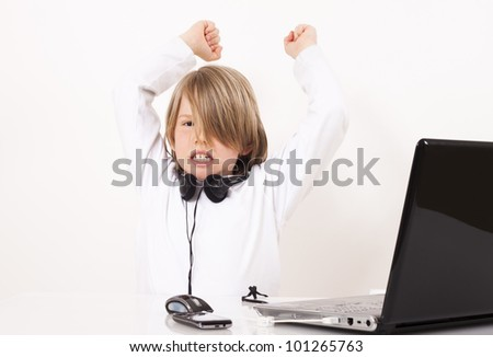 Angry young boy with a headset. - stock photo