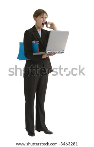 Angry, young business woman with computer and folders - yelling into a cell phone. Image is isolated on a white background. - stock photo