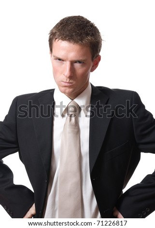 angry young businessman isolated on white background - stock photo