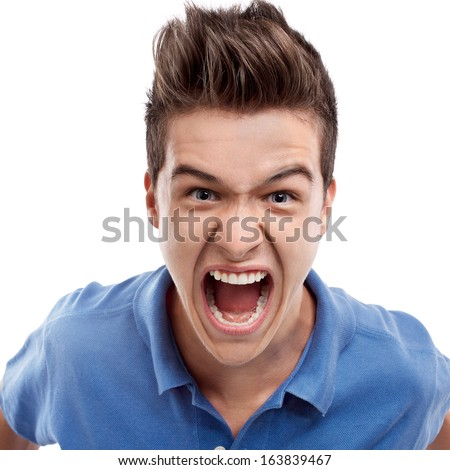 Angry young man looking straight forward and shouting - stock photo