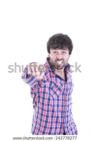 Angry young man pointing something - stock photo