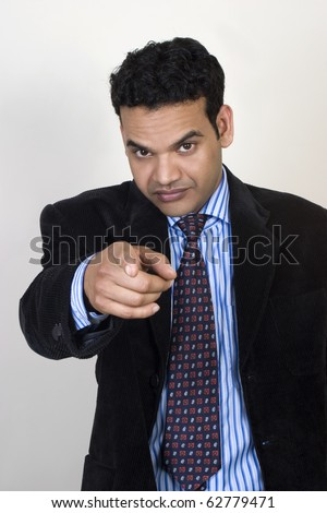 Angry young man Pointing The Finger, - stock photo