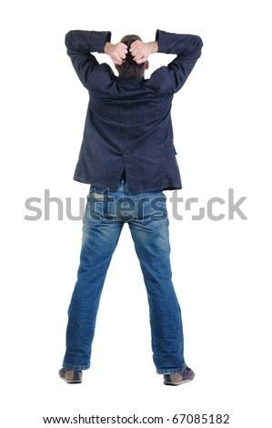 angry young man. Rear view. isolated over white. - stock photo