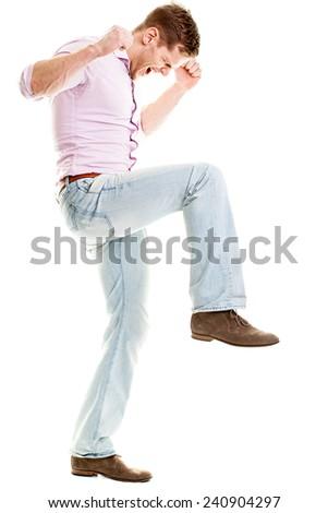 Angry young man smashing something - isolated on white background - stock photo