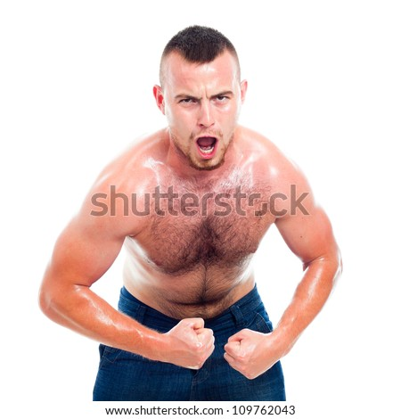 Angry young muscular sports man, isolated on white background. - stock photo