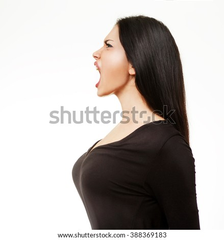 Angry young woman screaming - stock photo