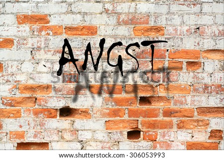 Angst - A road sign in german language, translation: fearful on decaying brick wall outdoors  - stock photo
