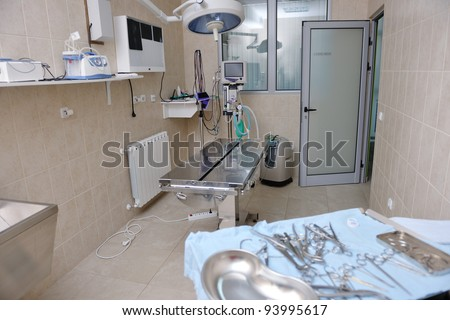 animal and pet surgery hospital room indoor with tools and instruments - stock photo