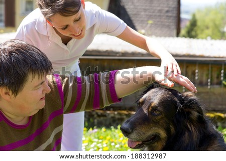 animal assisted therapy with a half breed dog - stock photo