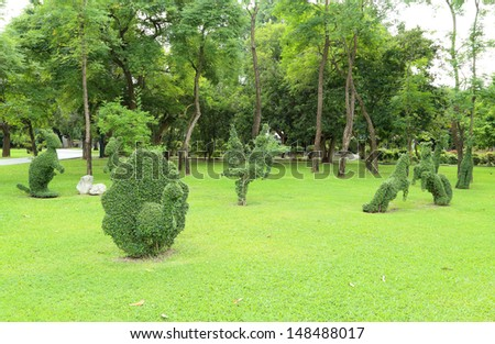 animal decoration tree in the park - stock photo